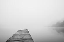 Wooden Footbridge On Lake With...