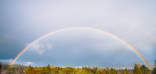 Full Rainbow Over Treetops In The Fall, In Southern Oregon, USA
