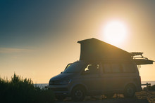 Camper Van With Tent On Roof A...