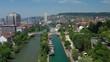 zurich city center summer day flight over riverside swimming bay aerial panorama 4k switzerland