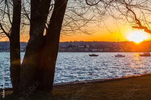 Fotografie, Tablou  Lungolago al tramonto, Lago Maggiore, Angera, Varese, Lombardia, Italia