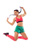 Smiling young female jumping and dancing zumba on white background.