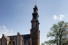 View Of Historical Westerkerk Church In Amsterdam. 17th Century Structure With 85 Meter Tall Spire. A Crown-topped Spire Rises From This Renaissance-era Protestant Church Where Rembrandt Is Buried.