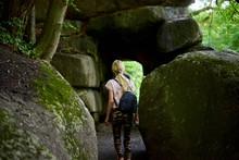 Teen Girl Near A Stone Cave