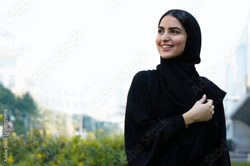 Happy Arabic woman wearing Hijab UAE headscarf looking far way Canvas Print
