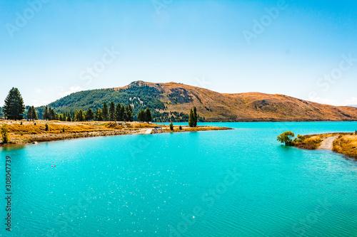 Photo Stands Turquoise Lake Tekapo, New Zealand