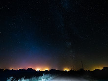 The Starry Sky And The Bright Milky Way Above The Village.