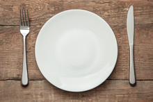 Empty White Plate With Knife A...