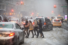 Winter Blizzard On The Streets Of New York City With Traffic Clogged And Cold Pedestrians