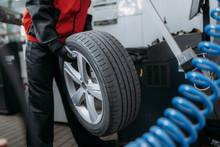 Repairman Puts The Wheel On Th...