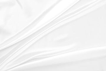 White gray satin texture that is white silver fabric silk background with beautiful soft blur pattern natural.