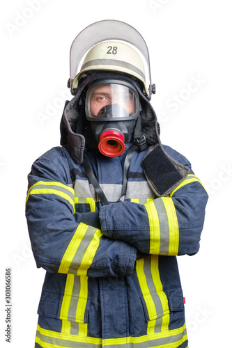 Cuadros en Lienzo  young firefighter in uniform in protective breathing mask on his head