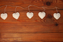 Eco Linen Fabric Hearts On Wooden Background,Valentines Day Concept Design.Decorative White Heart On Crafts Jute Twine Garland,natural Retro Burlap String. Hand Made Decorations For Lovers Day,flatlay