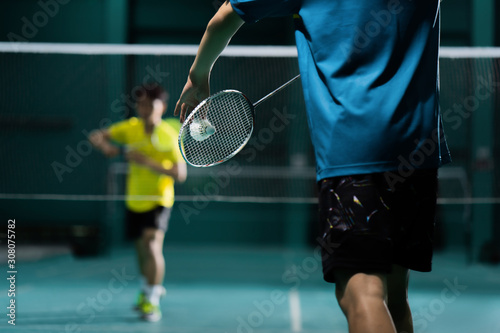 Asian badminton player is hitting in court Canvas Print