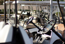 Golf Cars In The Parking Lot.
