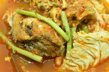 Fried Snake Head Fish And Egg Stuffed Climbing Wattle In Spicy Sour Soup On Bowl