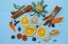 Ingredients For Mulled Wine. Cinnamon Sticks, Dry Rings Of Orange And Lemon, Peel Of An Orange, Anise Stars, Ginger, Cardamom, Cloves, Raisins. Christmas Composition. Concept Of Christmas And New Year