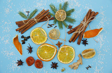 Ingredients For Mulled Wine. Cinnamon Sticks, Dry Rings Of Orange And Lemon, Peel Of An Orange, Anise Stars, Ginger, Cardamom, Cloves, Raisins. Snow Made Of Coconut. Christmas Or New Year Composition.