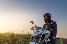Asian Woman With Helmet And Wearing And Fasten Before Riding Big Bike Motorcycle On The Road For Safety