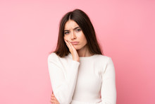 Young Woman Over Isolated Pink Background Unhappy And Frustrated