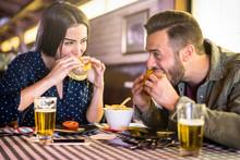 Happy Couple Having Fun Eating...