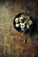 Quails Eggs In A Bowl On A  Ru...