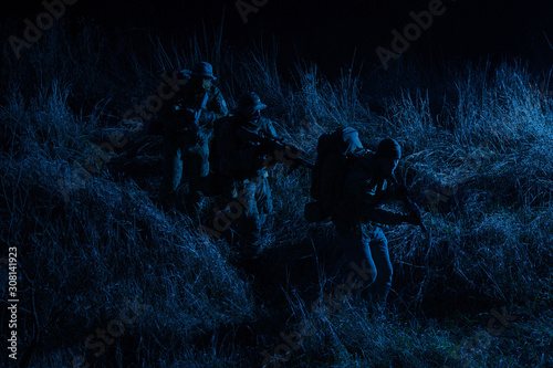 Photo  Army tactical group fighters sneaking in darkness