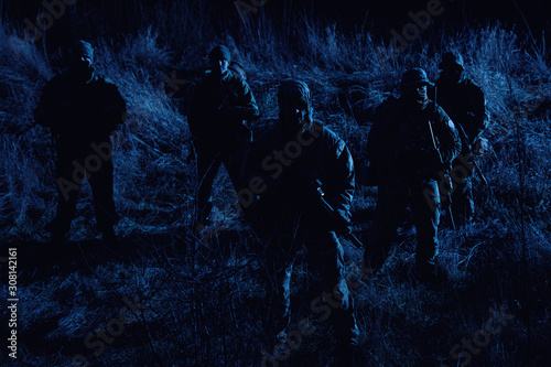 Fotografie, Tablou  Army soldiers crew patrolling territory at night