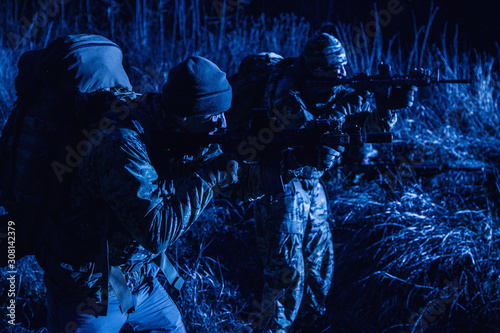 Border guards, army soldiers at night patrol Canvas Print