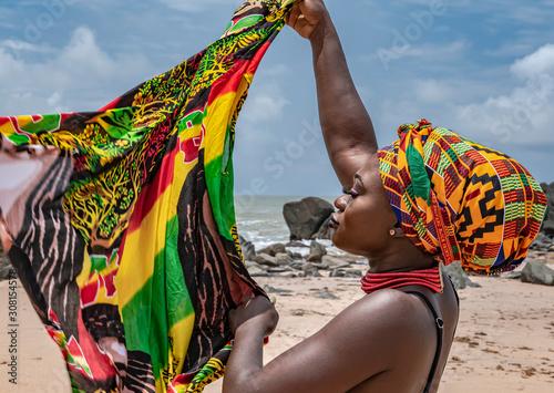 Obraz na płótnie Ghana woman on the beautiful beach of Axim, located in Ghana West Africa