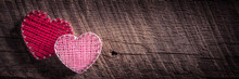 Two Heart Shapes Made Of Yarn And Nails On Rustic Wooden Background With Dark Vignette - Valentine's Day Concept