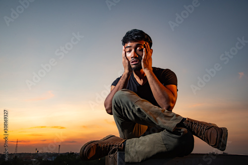 Asian Thai man got stress in beautiful sky Canvas Print