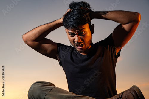 Photo Asian Thai man got stress in beautiful sky and low key