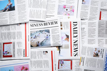 Many Different Newspapers As Background