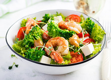 Delicious Fresh Salad With Shrimps / Prawns, Broccoli, Feta Cheese, Tomatoes, Lettuce And Peanut Dressing. Diet Menu. Top View
