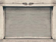 Steel Shutter Door Of Warehouse, Storage Or Storefront For Metal Door Background And Textured.
