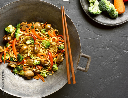 Udon stir-fry noodles with vegetables in wok Canvas Print
