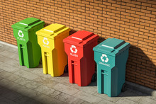 Top View Of Colorful Recycle Bins Near Brick Wall