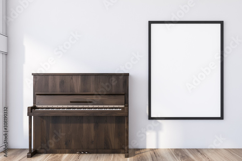 Wooden piano in white room with poster - 308190332