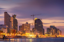 Tel Aviv Skyline, Israel. Cityscape Image Of Tel Aviv Beach With Some Of Its Famous Hotels During Sunrise And Night