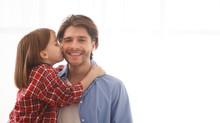 Adorable Little Girl Kissing H...