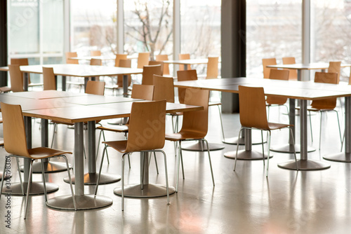 Tablou Canvas Interior of empty canteen with tables and chairs