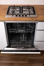 Dishwasher Integrated In A Modern Kitchen