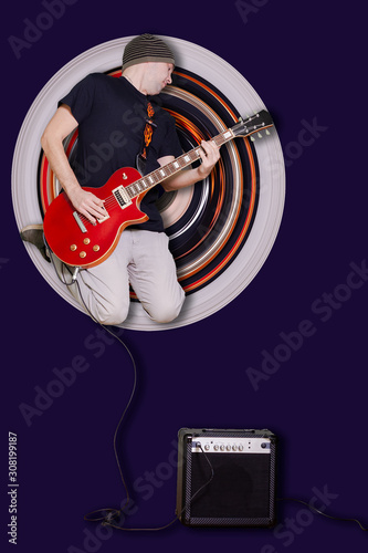 Young man with the red guitar in the jump on the round background of stretched pixels Canvas Print
