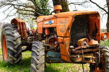 Old Orange Tractor Abandoned In A Field