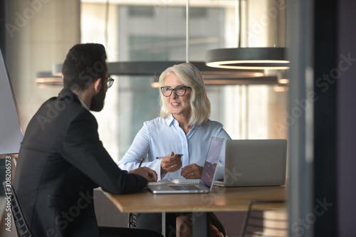 obraz dibond Multiethnic businesspeople brainstorm discussing ideas in office