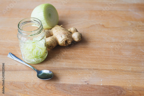 Fototapeta Homemade onion syrup with ginger on wooden background obraz