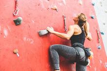 Sportswoman Climber Moving Up ...