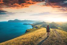 Girl Hiker Walking Above The Sea
