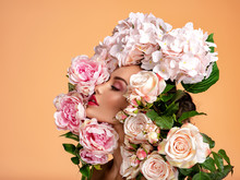 Beautiful White Girl With Flowers Around Face, Profile Portrait.  Attractive Girl With Big Many Flowers Near Face. Art Portrait, Woman And Flowers. Beauty Treatments. Spa Salon. Beauty Salon.
